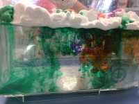 a photo of a tub of water with shaving cream on top