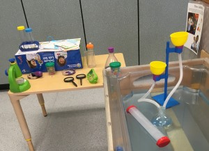 photo of pretend lab equipment in sensory table