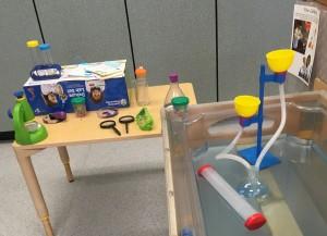 photo of pretend lab equipment in sensory table