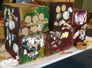 kids art project with lots of glue and cardboard
